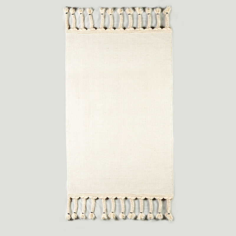 Area rug with fringed edging, by J. Leigh Carpets. White flatweave pictured.