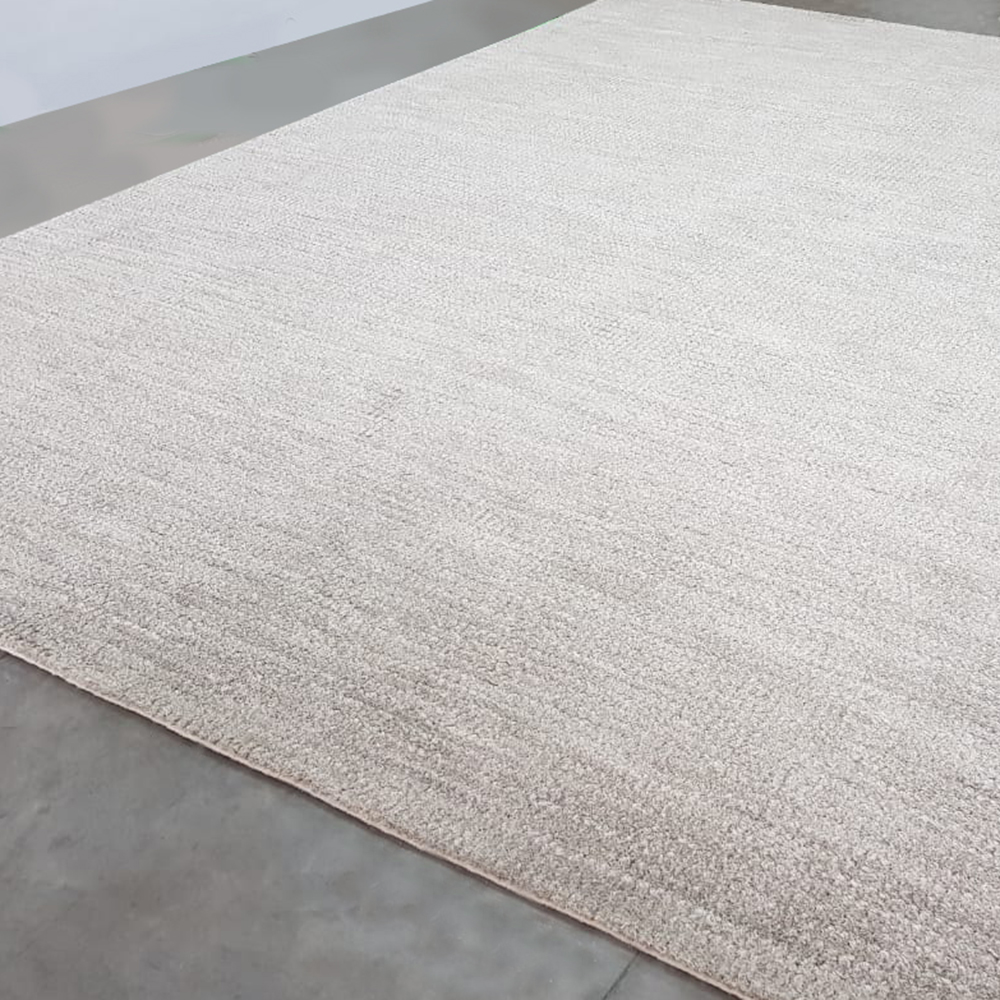 Area rug with serged edge, by J. Leigh Carpets. Jin Rickey in Speckled Grey, handloomed, Signature Area Rug, pictured.
