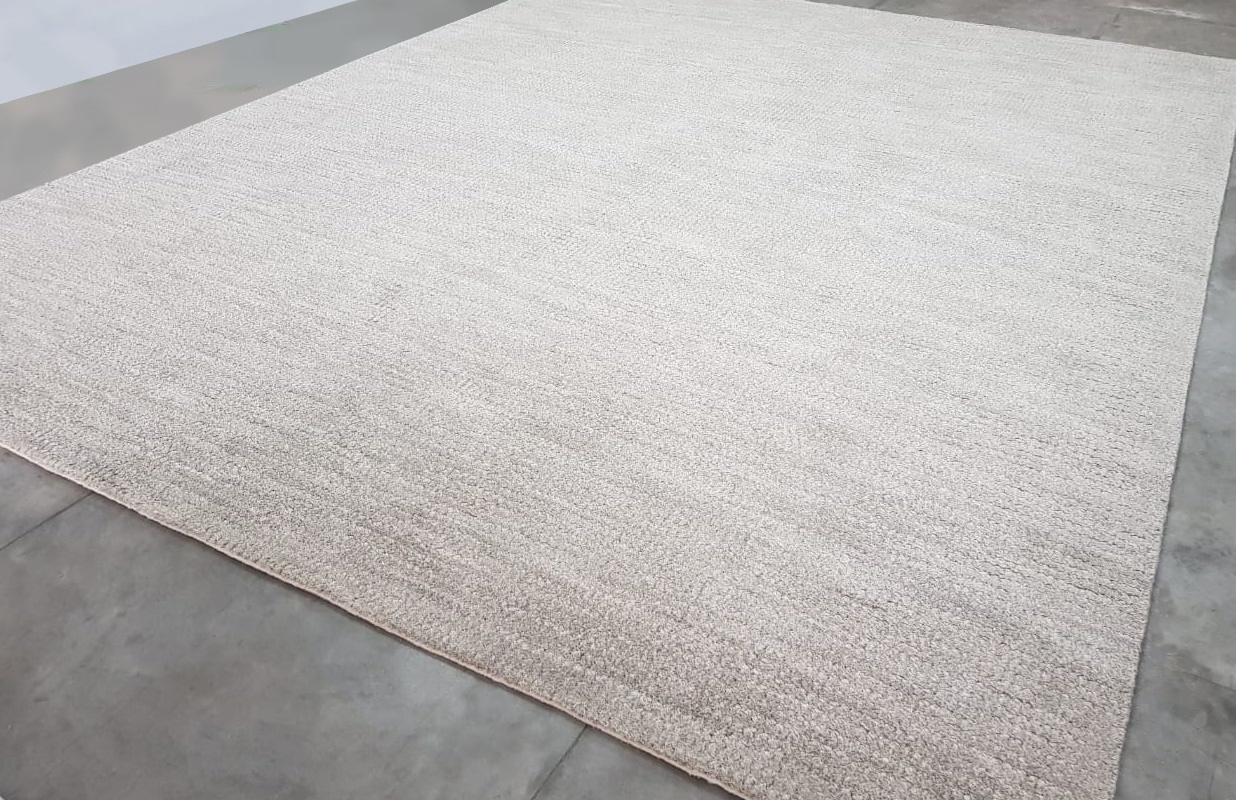 Jin Rickey Signature Area Rug by J. Leigh Carpets with serged edge